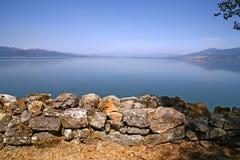 Macedonia, ex Yugoslav republic. South Europe. Stone wall on the lake Royalty Free Stock Images