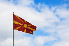 Macedonia Flag on cloudy sky, Skopje Royalty Free Stock Photography