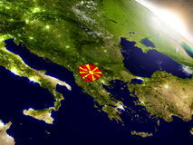 Macedonia with flag in rising sun Stock Photography