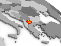 Macedonia on globe with flag Stock Photos