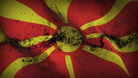 Macedonia grunge dirty flag waving on wind. Macedonian background fullscreen grease flag blowing on wind. Realistic filth fabric texture on windy day Stock Photo