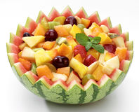 Macedonia in watermelon. Mixed Marinated Fruit in a cup of watermelon Stock Photography