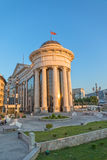 Macedonian archaeological museum in Skopje. SKOPJE, MACEDONIA - JULY 17, 2015: Macedonian archaeological museum famous building in sunset and the pedestrians Royalty Free Stock Photography