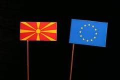 Macedonian flag with European Union EU flag isolated on black. Background Stock Image