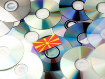 Macedonian flag on top of CD and DVD pile isolated on white Stock Images