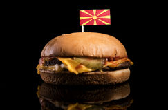 Macedonian flag on top of hamburger isolated on black Royalty Free Stock Photos