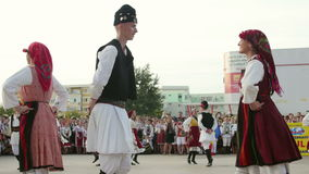 Macedonian traditional dance at the International Folklore Festival. TULCEA, ROMANIA - AUGUST 08: Macedonian traditional dance at the International Folklore stock video footage