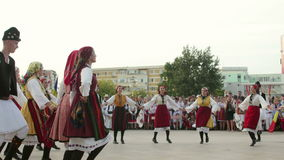 Macedonian traditional dance at the International Folklore Festival. TULCEA, ROMANIA - AUGUST 08: Macedonian traditional dance at the International Folklore stock footage
