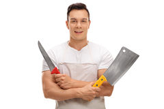 Macellaio che tiene una mannaia e un coltello Fotografia Stock