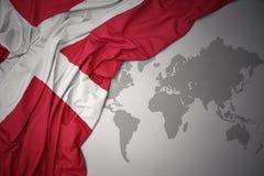 Machać kolorową flaga państowowa Denmark Zdjęcia Stock
