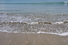 Macha piaskowatą plażę Zdjęcia Royalty Free