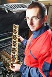 Machanic repairman at automobile Royalty Free Stock Photography