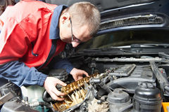 Machanic repairman at automobile car engine repair. Mechanic repairman at automobile car engine maintenance repair work Stock Photo