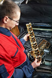 Machanic repairman at automobile car engine repair Royalty Free Stock Photo