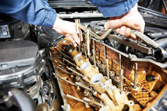 Machanic repairman at automobile car engine repair Stock Photography