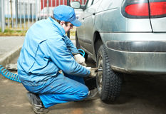 Machanic repairman at tyre fitting Royalty Free Stock Image