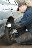 Machanic repairman at tyre replacement Stock Images