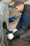 Machanic repairman at tyre replacement Stock Photography