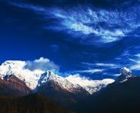 Machapuchare and Annapurna range, Nepal. Machapuchare and Annapurna peaks over clouds, Nepal royalty free stock photo