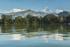 The Machapuchare and Annapurna III seen Pokhara, Nepal. The Machapuchare and Annapurna range seen from Phewa Lake in Pokhara, Nepal royalty free stock image