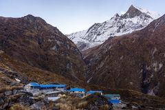 Machapuchare Base Camp village and snowcapped Machapuchare peak Fish Tail behind, Himalayas stock photos