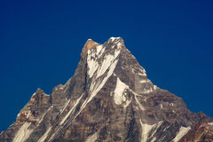 Machapuchare or Fishtail peak with blue sky background. Stock Photography