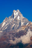 Machapuchare or Fishtail peak with blue sky background. Stock Photo