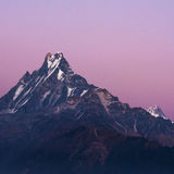 Machapuchare or Fishtail peak with sunset sky. Stock Photography