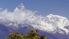 Machapuchare mountain. Nepal landscape. Machapuchare mountain view from Poon Hill with blue sky background. Nepal landscape, Annapurna circuit, Himalaya, Asia stock video