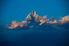 Machapuchre Himalayan Peak Clouds Stock Images