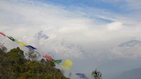 The Machapuchre and prayer flags, Nepal stock video footage