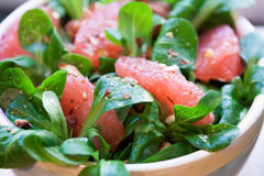 Mache Salad with Grapefruit Sections. Mache (also known as Corn Salad, Lambs Lettuce and Nuesslisalad) salad with grapefruit sections, toasted almonds, almond stock images