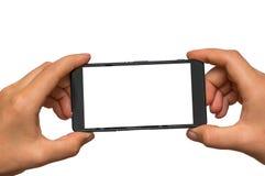 Machen des Fotos mit Handy des leeren weißen Schirmes Stockfoto