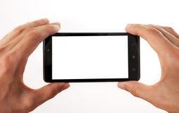 Machen des Fotos mit Handy des leeren weißen Schirmes stockbild