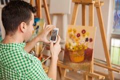Machen eines Fotos seiner Kunst stockfotografie