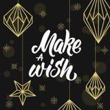 Machen Sie einen Wunsch! Geometrische Weihnachtsdekorationen und -beschriftung Stockfoto