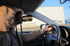 Machen von Fotos innerhalb des Autos Lizenzfreies Stockbild