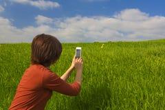 Machen von Fotos mit einem Mobiltelefon Stockfoto