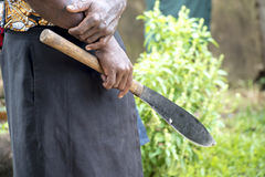Machete in hand Stock Images