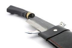 Machete with leather case over white Stock Images