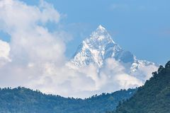 Machhapuchhre, a fish shaped peak over the Pokhara. Mountain in the Annapurna Himalayas of north central Nepal Stock Photo