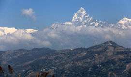 The Machhapuchhre (Fishtail) towering above the foothills. From the peace pagoda looking over to the Annapurna range of mountains. The mountains appear from the Royalty Free Stock Photos