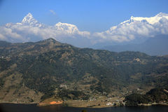 The Machhapuchhre (Fishtail) towering above Phewa Lake Royalty Free Stock Images