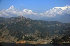 The Machhapuchhre (Fishtail) towering above Phewa Lake Royalty Free Stock Images