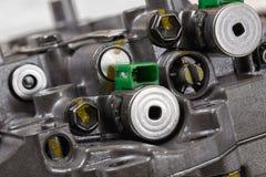 Machinalna część z metali składnikami i hydraulicznymi klapami Fotografia Royalty Free