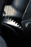Machinalny tło z gearwheel lub flywheel silnik zdjęcia stock
