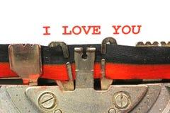 Machine à écrire écrite JE T'AIME avec l'encre rouge Photos stock
