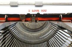 Machine à écrire écrite JE T'AIME avec l'encre rouge Photo stock