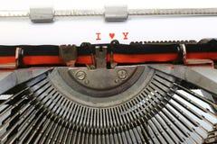 Machine à écrire écrite JE T'AIME avec l'encre rouge Photo libre de droits