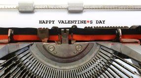 Machine à écrire écrite jour de valentines heureux Photos stock